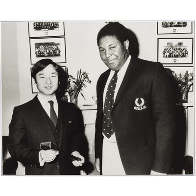The Crown Prince receiving a club necktie from the then-president Patrick Mbu after his election to the club, 1984, Vincent's Club